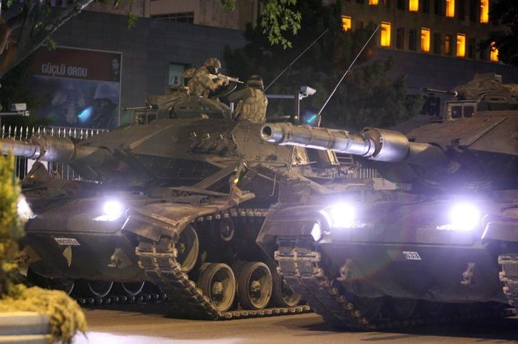 A military aims his weapon on top of a tank during an attempted coup in Ankara, Turkey July 16, 2016.  REUTERS/Stringer/Files