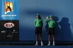 Ball boys are pictured at the Australian Open tennis tournament at Melbourne Park, Australia, January 19, 2016. REUTERS/Tyrone Siu