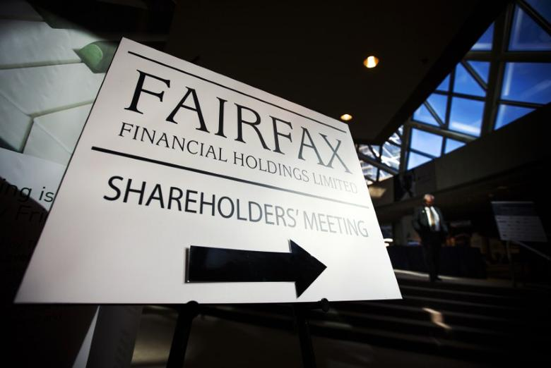 A man walks past a Fairfax Holdings sign directing shareholders to the meeting, at the annual general meeting for shareholders in Toronto, April 9, 2014.  REUTERS/Mark Blinch