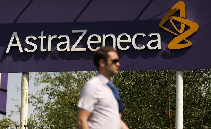 A man walks past a sign at an AstraZeneca site in Macclesfield, central England May 19, 2014. REUTERS/Phil Noble/Files