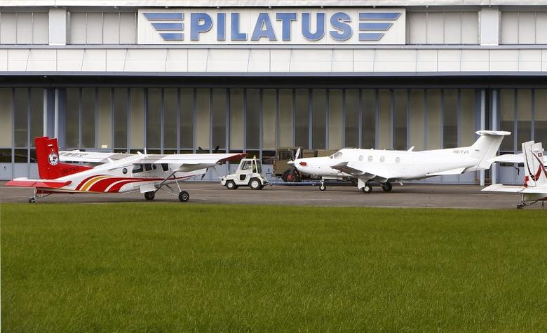 A Pilatus PC-12 airplane pulled by an aircraft tug in front of the plant of Swiss Pilatus Aircraft Ltd. in the central Swiss town of Stans October 30, 2014. REUTERS/Arnd Wiegmann
