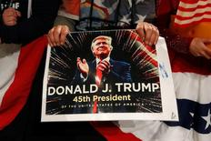A supporter of U.S. President-elect Donald Trump holds a sign at the USA Thank You Tour event at the Iowa Events Center in Des Moines, Iowa, U.S., December 8, 2016. REUTERS/Shannon Stapleton