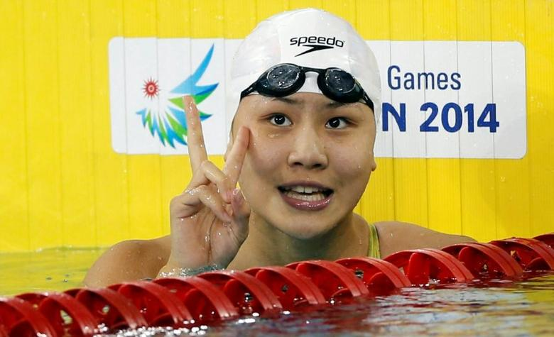 FILE PHOTO - China's Chen Xinyi celebrates after winning the women's 50m freestyle final swimming competition at the Munhak Park Tae-hwan Aquatics Center during the 17th Asian Games in Incheon September 26, 2014. REUTERS/Tim Wimborne/File Photo