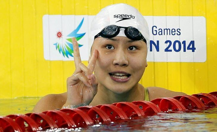 China's Chen Xinyi celebrates after winning the women's 50m freestyle final swimming competition at the Munhak Park Tae-hwan Aquatics Center during the 17th Asian Games in Incheon September 26, 2014. REUTERS/Tim Wimborne/File Photo