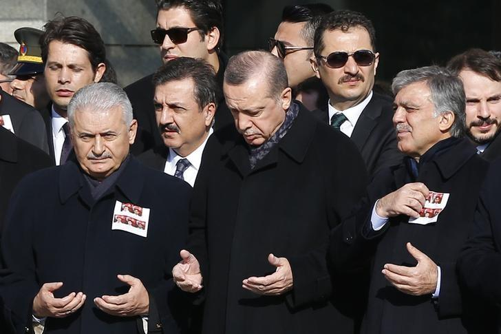 Turkish Prime Minister Binali Yildirim, President Tayyip Erdogan and Former President Abdullah Gul pray during a ceremony for police officers killed in Saturday's blasts in Istanbul, Turkey, December 11, 2016. REUTERS/Murad Sezer