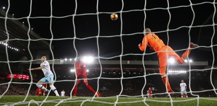 Football Soccer Britain - Liverpool v West Ham United - Premier League - Anfield - 11/12/16 West Ham United's Darren Randolph fumbles the ball for Liverpool's Divock Origi to score their second goal  Action Images via Reuters / Lee Smith Livepic