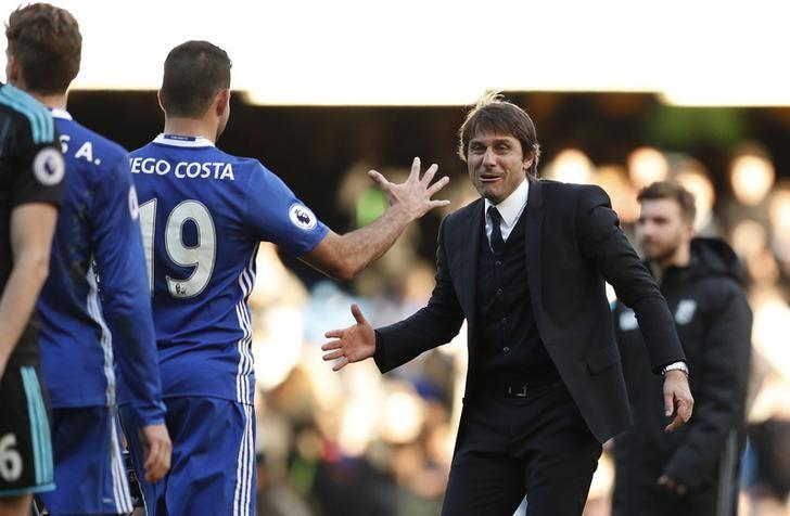 Football Soccer Britain - Chelsea v West Bromwich Albion - Premier League - Stamford Bridge - 11/12/16 Chelsea manager Antonio Conte celebrates after the game with Diego Costa  Action Images via Reuters / John Sibley Livepic