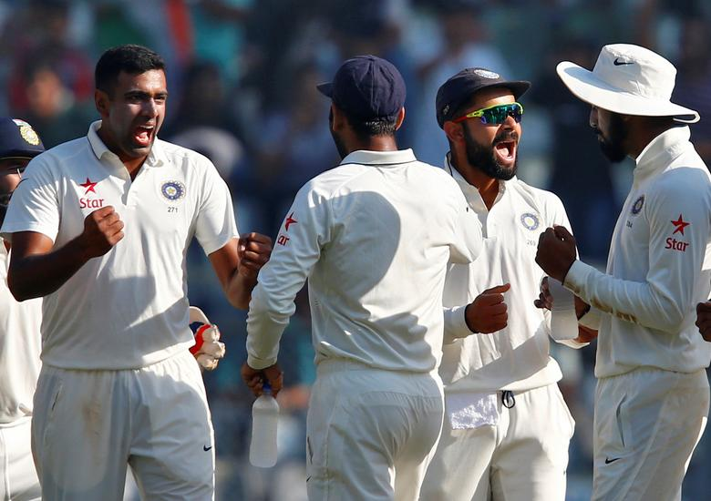 India v England - Fourth Test cricket match - Wankhede Stadium, Mumbai - 12/12/16. India's Ravichandran Ashwin (L) and Virat Kohli (2nd R) celebrate the wicket of England's Jonny Bairstow. REUTERS/Danish Siddiqui