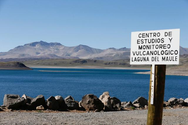 The Laguna del Maule (Lagoon of Maule) is seen in the VII region of Talca, south of Santiago,  Chile  November 29, 2016. The sign reads, ''Center of monitoring and volcanological studies, Laguna del Maule''. REUTERS/Rodrigo Garrido