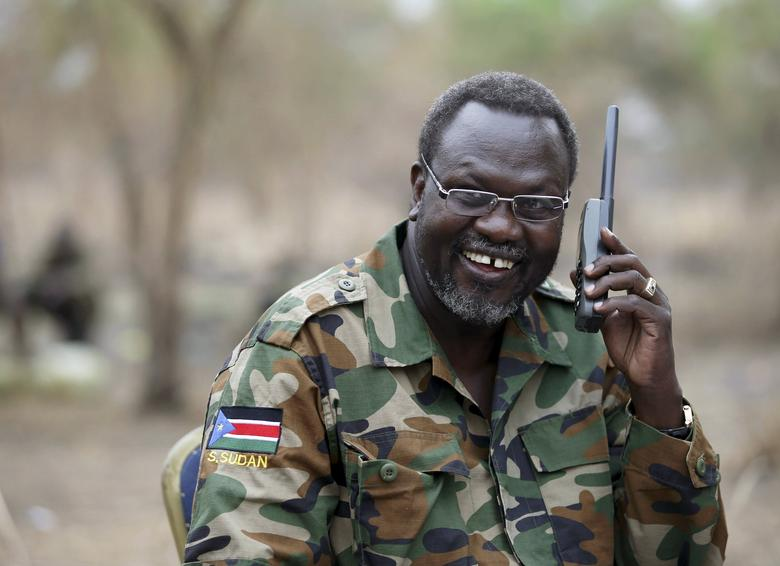 South Sudan's rebel leader Riek Machar talks on the phone in his field office in a rebel-controlled territory in Jonglei State, South Sudan, February 1, 2014. REUTERS/Goran Tomasevic/Files