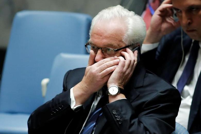 Russia Ambassador Vitaly Churkin talks on the phone before a vote on a draft resolution that demands an immediate end to air strikes and military flights over Syria's Aleppo city, at the U.N. Headquarters in New York, U.S., October 08, 2016. REUTERS/Eduardo Munoz