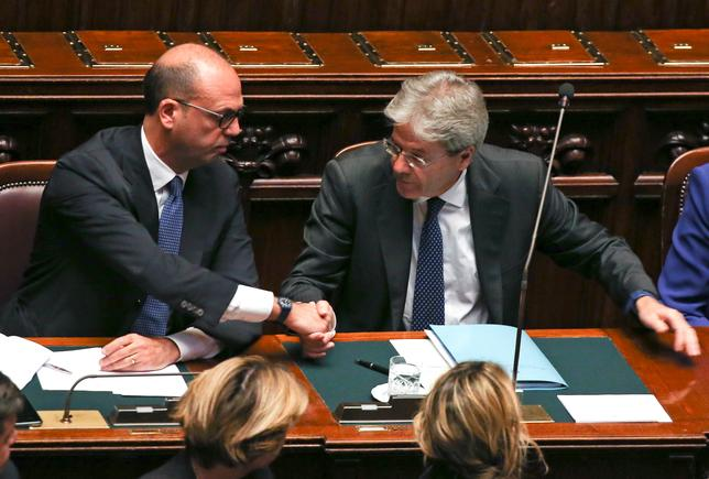 Newly appointed Italian Prime Minister Paolo Gentiloni (R) is congratulated by Foreign Minister Angelino Alfano at the end of a speech before a confidence vote at the parliament in Rome, Italy, December 13, 2016. REUTERS/Alessandro Bianchi