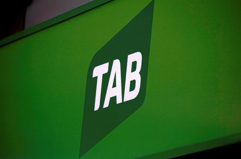 The logo for Australian gambling company Tabcorp Holdings Ltd (TAB) is displayed outside a TAB branch in central Sydney, Australia, October 18, 2016.    REUTERS/David Gray/File photo