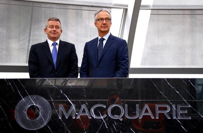 Nicholas Moore (R), Chief Executive of Australia's biggest investment bank Macquarie Group Ltd, reacts as he stands with Chief Financial Officer Patrick Upfold at the company's Sydney office headquarters in Australia, October 28, 2016.    REUTERS/David Gray