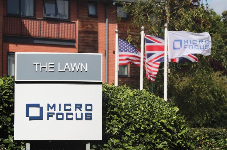 Signs and flags are seen outside the offices of Micro Focus in Newbury, Britain, September 8, 2016. REUTERS/Eddie Keogh