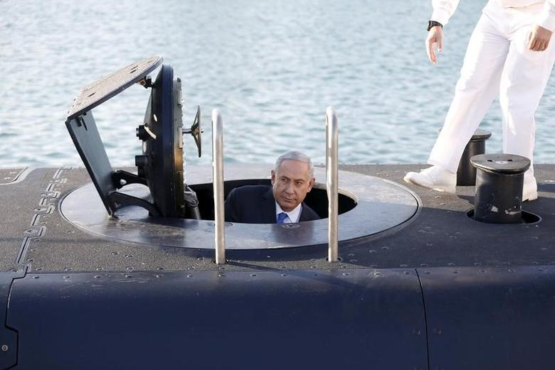 Israeli Prime Minister Benjamin Netanyahu climbs out after a visit inside the Rahav, the fifth submarine in the fleet, after it arrived in Haifa port January 12, 2016. REUTERS/Baz Ratner/File Photo