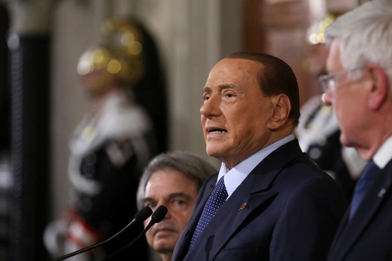 Italy's former Prime Minister Silvio Berlusconi (C) speaks at the end of his consultations with Italian President Sergio Mattarella at the Quirinale Palace in Rome, Italy December 10, 2016. REUTERS/Alessandro Bianchi
