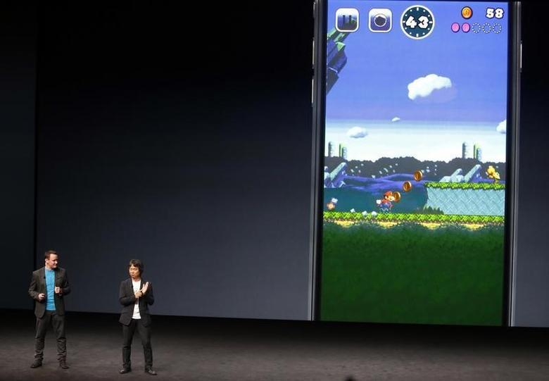 Nintendo Creative Fellow Shigeru Miyamoto announces a Mario Bros game for the iPhone, as a translator stands nearby, during an Apple media event in San Francisco, California, U.S. September 7, 2016.  REUTERS/Beck Diefenbach