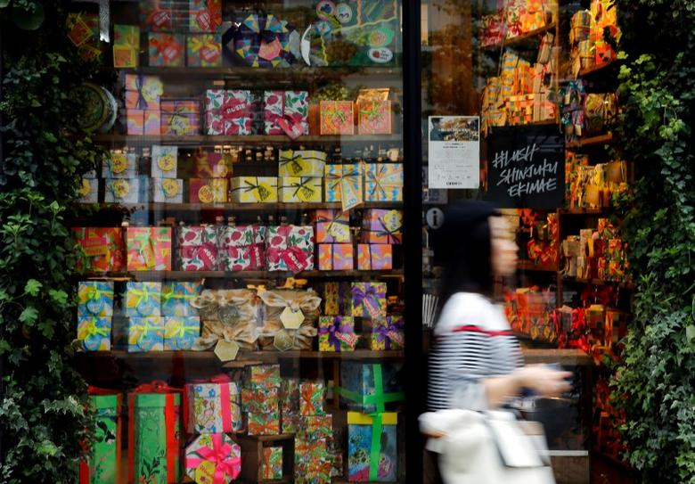 A woman walks outside a shop in a shopping district in Tokyo, Japan, September 29, 2016.   REUTERS/Toru Hanai/File Photo