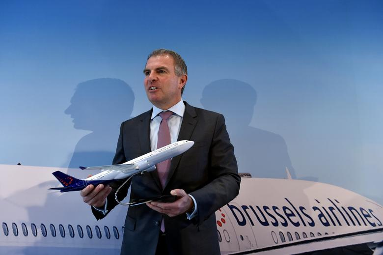 Lufthansa CEO Carsten Spohr holds a Brussels Airlines model airplane after a news conference on the Lufthansa deal to fully take over Brussels Airlines in Zaventem, Belgium December 15, 2016. REUTERS/Eric Vidal