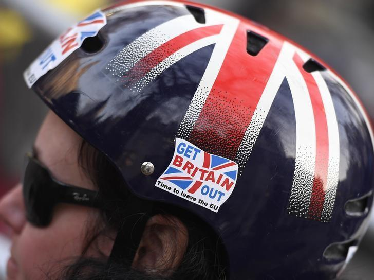 A cyclist wears a pro-Brexit badge on her Union flag themed helmet outside the Supreme Court on the first day of the challenge against a court ruling that Theresa May's government requires parliamentary approval to start the process of leaving the European Union, in Parliament Square, central London, Britain December 5, 2016. REUTERS/Toby Melville /Files