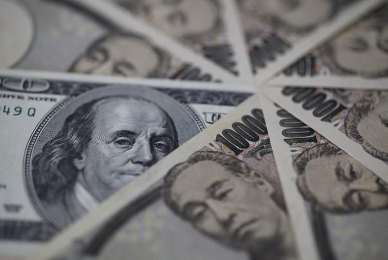 A U.S. one-hundred dollar bill (C) and Japanese 10,000 yen notes are spread in Tokyo, in this February 28, 2013 picture illustration. REUTERS/Shohei Miyano