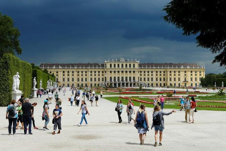 People walk in the park in front of imperial Schoenbrunn palace in Vienna, Austria, June 14, 2016. REUTERS/Heinz-Peter Bader