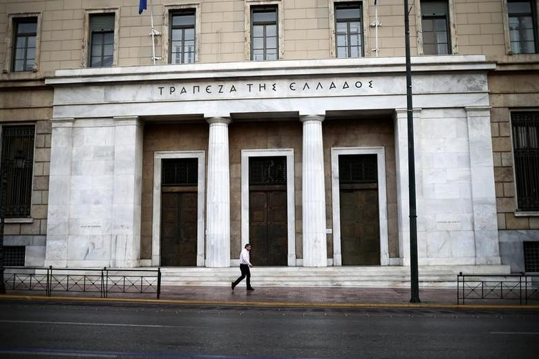 A man walks past the headquarters of the Central Bank of Greece in Athens, Greece, November 8, 2016.  REUTERS/Alkis Konstantinidis