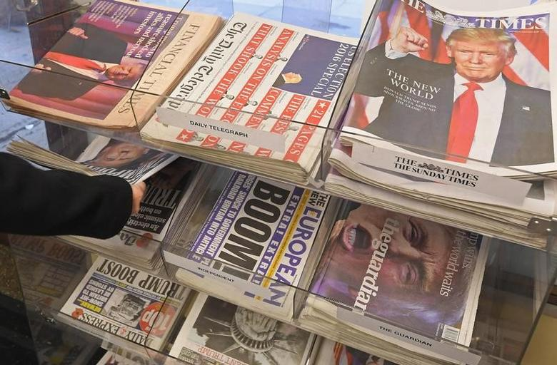 British newspapers are seen with their reaction to the story of U.S. President-elect Donald Trump at a corner shop in London, Britain, November 10, 2016. REUTERS/Toby Melville
