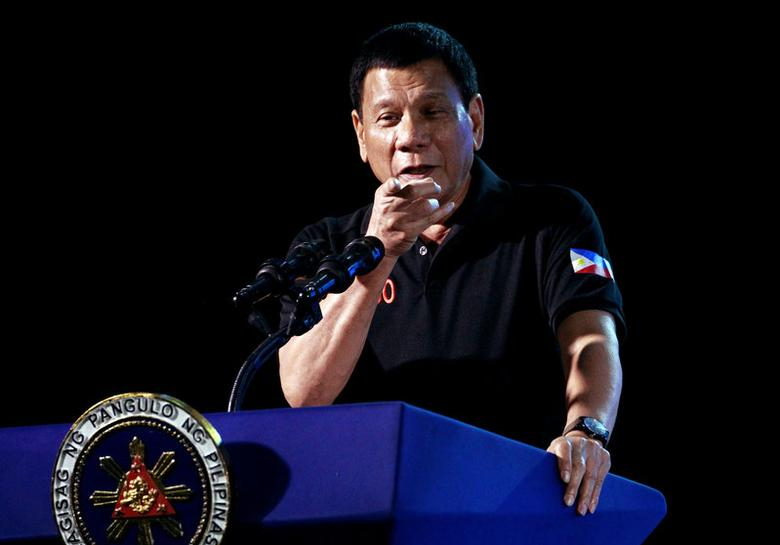 Philippine President Rodrigo Duterte speaks during a visit to Camp Servillano S. Aquino in San Miguel, Tarlac, Philippines December 11, 2016. REUTERS/ Czar Dancel
