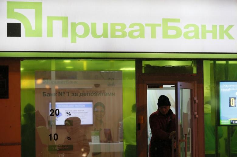 A man leaves a branch of Privatbank in Kiev, Ukraine December 14, 2016. REUTERS/Valentyn Ogirenko