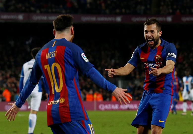 Barcelona's Lionel Messi and Jordi Alba celebrate the team's goal. REUTERS/Albert Gea