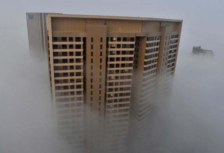 An apartment building is seen on a hazy day in Hefei, Anhui province, March 26, 2014.  REUTERS/Stringer/File Photo