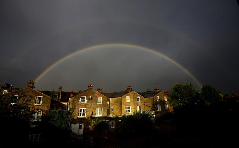 A double rainbow is seen above a row of terrace houses in Clapham, south London, Britain September 1, 2015.    REUTERS/Dylan Martinez/File Photo