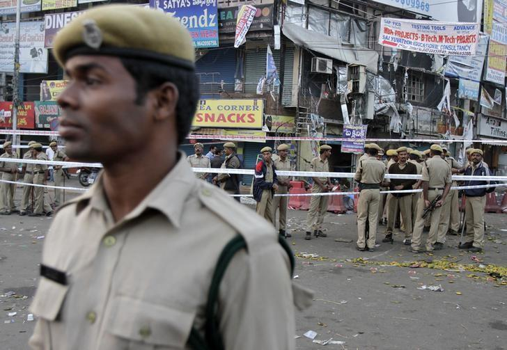 Policemen stand guard at the site of an explosion at Dilsukh Nagar in Hyderabad February 22, 2013. REUTERS/Krishnendu Halder/Files