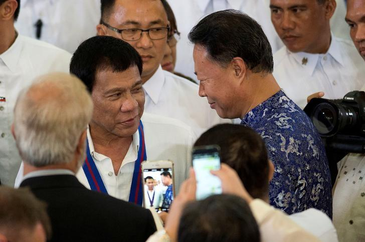 Philippine President Rodrigo Duterte (L) talks with Chinese Ambassador to the Philippines Zhao Jianhua (R) during the 115th Police Service Anniversary at the Philippine National Police (PNP) headquarters in Quezon city, metro Manila, Philippines August 17, 2016. To match Special Report PHILIPPINES-DRUGS/CHINA    REUTERS/Noel Celis/Pool/File Photo