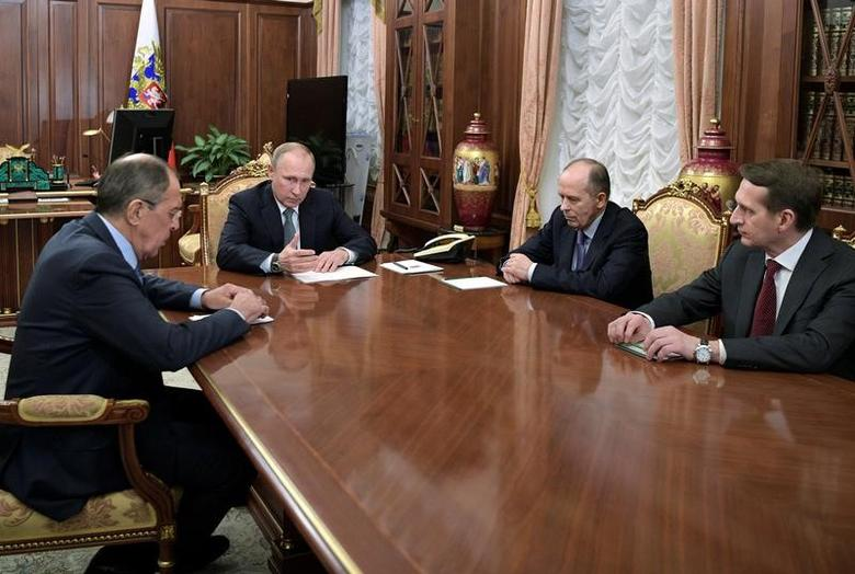 Russia's President Vladimir Putin (2nd L), Foreign Minister Sergei Lavrov (L), Director of Russian Federal Security Service (FSB) Alexander Bortnikov (2nd R), and Director of Foreign Intelligence Service (SVR) Sergei Naryshkin attend a meeting dedicated to the murder of Russian Ambassador to Turkey Andrei Karlov, at the Kremlin in Moscow, Russia December 19, 2016. Sputnik/Kremlin/Alexei Druzhinin via REUTERS