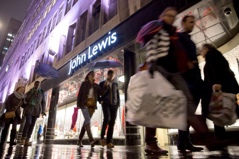 Pedestrians walk past a John Lewis store on Oxford Street in central London December 15, 2013. REUTERS/Neil Hall