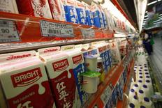 Milk produced by Bright Food is displayed for sale on shelves at a supermarket in Shanghai September 27, 2010.  REUTERS/Aly Song