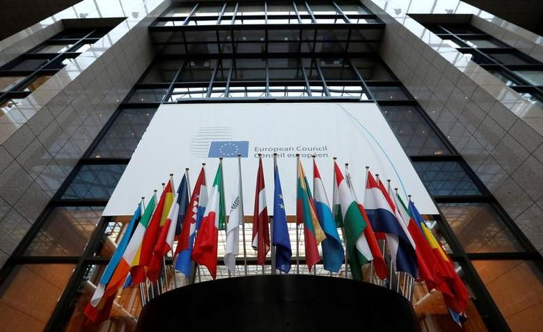 Flags are seen inside the European Council headquarters on the eve of a EU Summit in Brussels, Belgium December 14, 2016.   REUTERS/Yves Herman