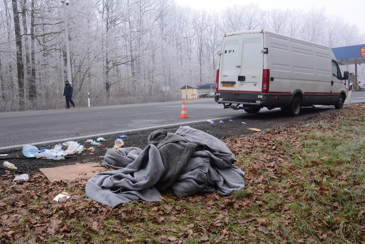 Items from migrants are seen next to a van near Novska, Croatia, December 18, 2016. Nikola Cutuk/PIXSELL/via Reuters