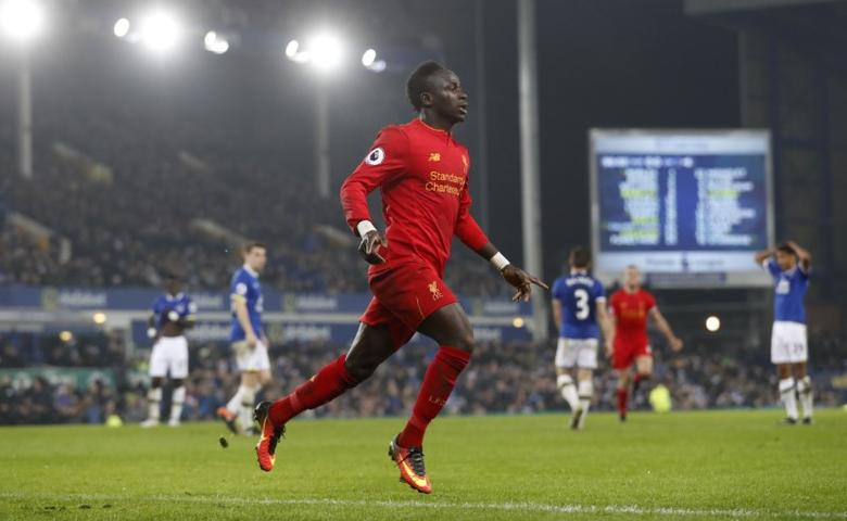 Britain Football Soccer - Everton v Liverpool - Premier League - Goodison Park - 19/12/16 Liverpool's Sadio Mane celebrates scoring their first goal  Action Images via Reuters / Carl Recine Livepic
