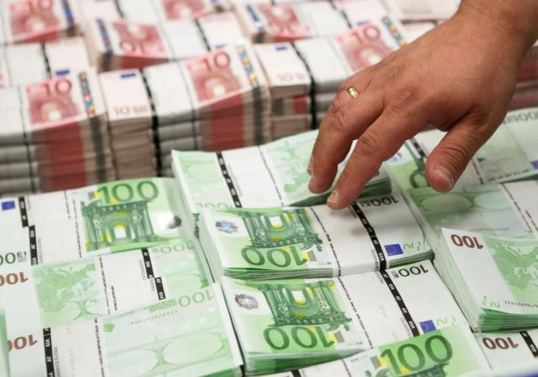 FILE PHOTO: Wads of 10 and 100 euro banknotes are stacked at the GSA company's headquarters in Vienna, Austria July 22, 2013.  REUTERS/Leonhard Foeger/File Photo