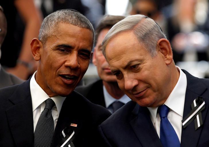 U.S. President Barack Obama (L) speaks to Israeli Prime Minister Benjamin Netanyahu during the burial ceremony of former Israeli President Shimon Peres at Mount Herzl Cemetery in Jerusalem September 30, 2016. REUTERS/Ronen Zvulun/Files