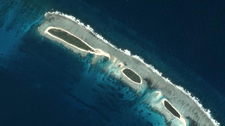 A destroyed land bridge (top) is seen in this view of a North Island, near Tree Island and Woody Island in the Paracel chain, in the South China Sea November 14, 2016 in this Planet Labs handout photo received by Reuters on November 30, 2016. Trevor Hammond/Planet Labs/Handout via REUTERS