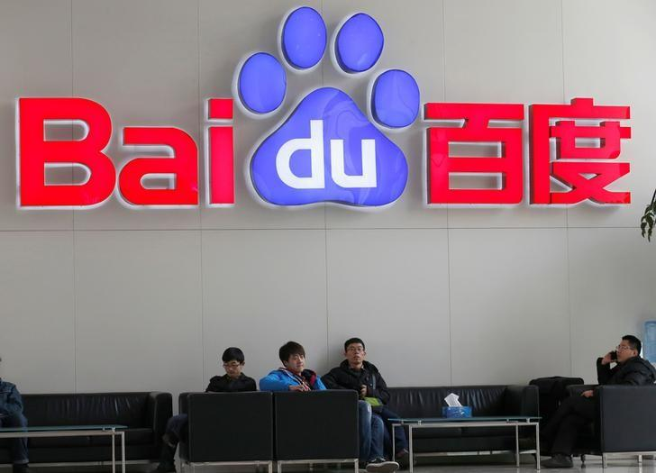 People sit in front of the company logo of Baidu at its headquarters in Beijing December 17, 2014. REUTERS/Kim Kyung-Hoon/Files