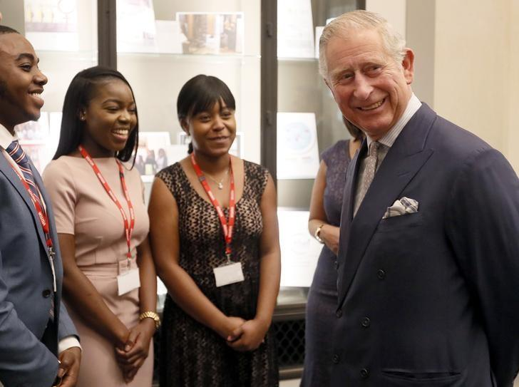 Britain's Prince Charles meets people on a Scholarship programme during a visit to the Bank in London, December 7, 2016. REUTERS/Kirsty Wigglesworth/Pool/Files