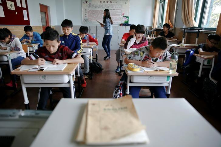 Students at the Shichahai sports school attend a class in Beijing, China, May 18, 2016. REUTERS/Damir Sagolj/Files