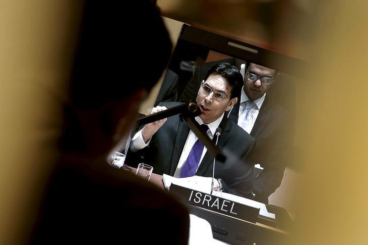 Israel's Ambassador to the United Nations Danny Danon is seen on a screen in an interpreters booth as he addresses a United Nations Security Council meeting on the Middle East at U.N. headquarters in New York, January 26, 2016.  REUTERS/Mike Segar/Files