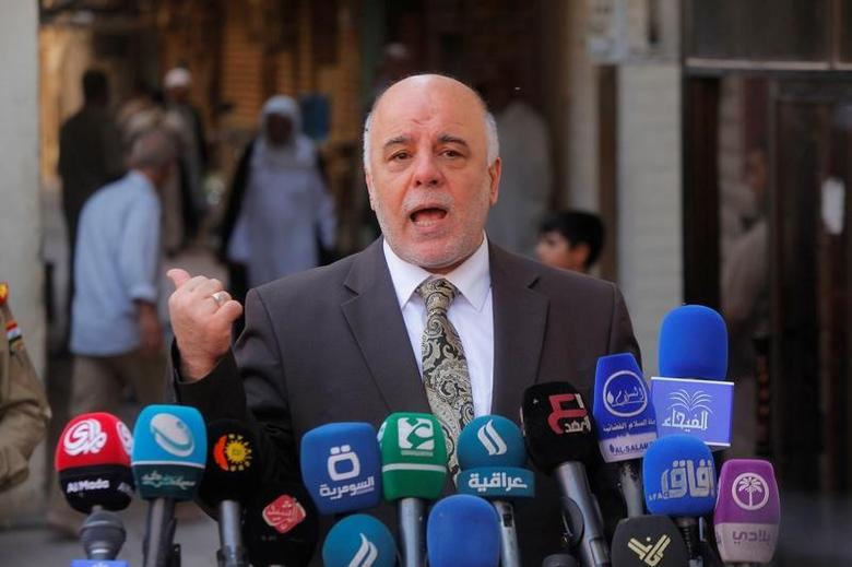 Iraqi Prime Minister Haider al-Abadi speaks to reporters after a meeting with the top Shiite cleric, Grand Ayatollah Ali al-Sistani, in the Shiite holy city of Najaf, south of Baghdad, October 20, 2014.  REUTERS/Alaa Al-Marjani/File Photo
